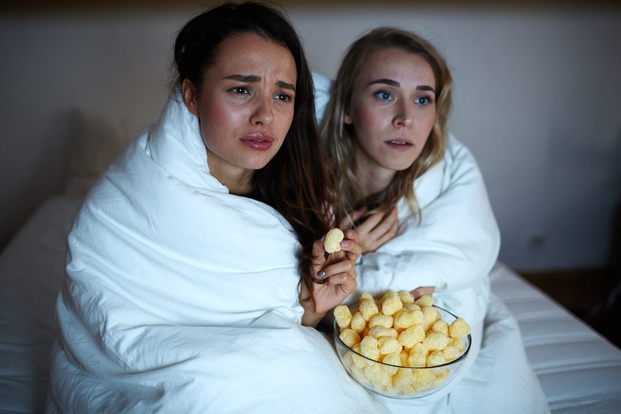 Emotional girls wrapped into blanket